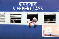 Passengers hanging at the window of an Indian Railway wagon Royalty Free Stock Image