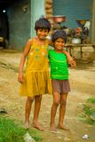 Jaipur, India - September 20, 2017: Portrait of two beautiful girls hugging and smiling, wearing a yellow dirty blouse Royalty Free Stock Photography