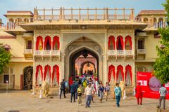 JAIPUR, INDIA - SEPTEMBER 19, 2017: Unidentified people at the entrance gate to the City Palace in Jaipur, India Stock Image