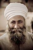 Jaipur man in a turban. Man with beard wearing a white turban in Jaipur Stock Photography