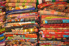 Jaipur quilts. Stack of colorful Jaipur (India) quilts Stock Images