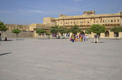 Jaipur, Rajasthan, India: Majestic courtyard of Amber Fort in Jaipur, tourists enjoying the architecture of the palace Royalty Free Stock Images