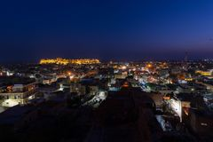 Jaisalmer cityscape at dusk. The majestic fort dominating the city. Scenic travel destination and famous tourist attraction in the Royalty Free Stock Images