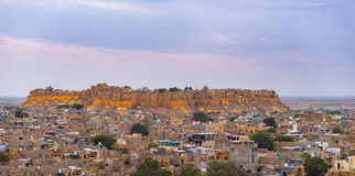 Jaisalmer cityscape at dusk. The majestic fort dominating the city. Scenic travel destination and famous tourist attraction in the Royalty Free Stock Image