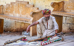 Jaisalmer Fort Rajasthan. A man playing traditional Rajasthani Hand Made musical instrumnet in Jaisalmer stock images
