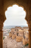 Jaisalmer fort view. City and fort view from the window in City Palace museum of Jaisalmer, Rajasthan, India royalty free stock photos