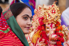 JAISALMER, INDIA - SEPTEMBER 8th: Devotee and the statue of Lord Ganesha during Ganesha Chaturthi festival Stock Photos