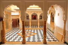 JAISALMER, RAJASTHAN, INDIA - DECEMBER 20, 2017: The interior of Jaisalmer Fort Palace wih arcades and patterned pavement. The interior of Jaisalmer Fort Palace Stock Images