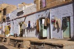 Jaisalmer Street Scene. Street scene in Jaisalmer. Washing drying in the sun against blue painted walls royalty free stock image