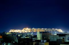Jaisalmers Sonar Quila or fort at night with cityscape. Cityscape of the famous Rajasthan town of Jaisalmer with the famous Sonar Quila or fort in the background Stock Image