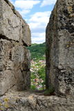 Jajce 3. Beautiful hill town of Jajce viewed from a slit of the Jajce Fortress wall Royalty Free Stock Photography