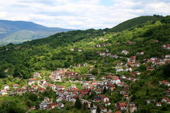 Jajce 2. Scenic hill town of Jajce in Bosnia and Herzegovina Republic, with sun light piercing through dark clouds shing on the hills Royalty Free Stock Photo