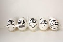 Jajka z malować twarzami Fotografia dla twój projekta Obrazy Royalty Free