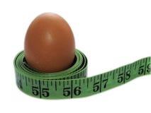 Jajko i centymetrowa taśma Zdjęcia Stock