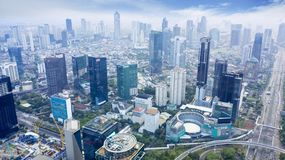 Jakarta Central Business District At Misty Morning Stock Photos