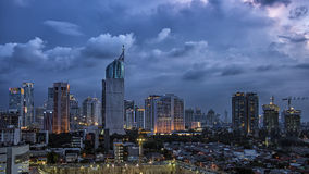 Jakarta city panorama. Storm over the city in indonesia stock photography