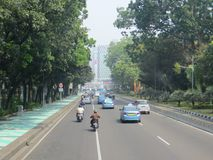 Jakarta city street. JAKARTA, INDONESIA - August 2, 2018: Traffic on Jalan Merdeka Barat royalty free stock photo