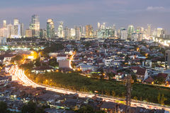 Jakarta cityscape. Jakarta, Indonesia capital city, is a mixed of modern buildings with villages like housing structure right in the center of the city royalty free stock photos