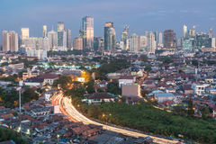 Jakarta cityscape. Jakarta, Indonesia capital city, is a mixed of modern buildings with villages like housing structure right in the center of the city stock images