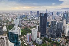 Jakarta cityscape at misty morning. JAKARTA - Indonesia. January 03, 2019: Drone view of Jakarta cityscape with skyscrapers at misty morning royalty free stock photo