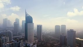 Jakarta cityscape with skyscraper in misty morning. JAKARTA - Indonesia. August 31, 2018: Aerial view of Jakarta cityscape with skyscraper in misty morning stock image
