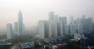 Jakarta del centro con i grattacieli e la nebbia stock footage