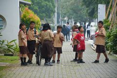 Elementary Boys and Girls Scout Jakarta. Jakarta heat during recess, these elementary kids were allowed to hang around the Indonesia National Gallery Stock Image