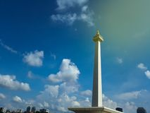 Clouds fly over Monas or National Monument. A historical landmark placed in Central Jakarta. JAKARTA, INDONESIA - APRIL 29, 2019 : Clouds fly over Monas or royalty free stock image
