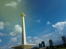 Clouds fly over Monas or National Monument. A historical landmark placed in Central Jakarta. JAKARTA, INDONESIA - APRIL 29, 2019 : Clouds fly over Monas or stock image