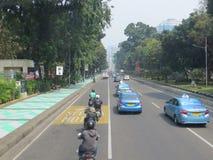 Jakarta city street. JAKARTA, INDONESIA - August 2, 2018: Traffic on Jalan Merdeka Barat stock photography