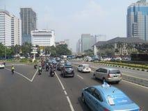 Jakarta city street. JAKARTA, INDONESIA - August 2, 2018: Traffic on Jalan Merdeka Barat royalty free stock photos
