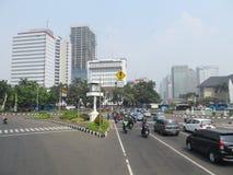 Jakarta city street. JAKARTA, INDONESIA - August 2, 2018: Traffic on Jalan Merdeka Barat royalty free stock image