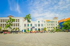 JAKARTA, INDONESIA: beautiful view of white building of the bank mega with people in the plaza enjoying the beautiful. Day Stock Photography