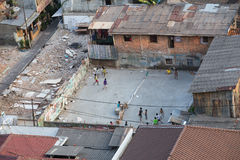 Jakarta, Indonesia - circa October 2015: Kids are playing games in slums of  Jakarta Stock Images