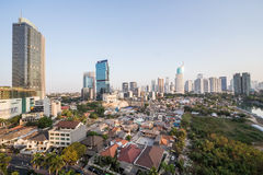 Jakarta, Indonesia - circa October 2015: Slums and skyscrapers of Jakarta, city of  contrasts Stock Photos