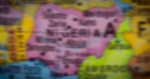 Nigeria country map on the globe. Jakarta - Indonesia. February 14, 2018: Closeup of Nigeria country map on a world map. Nigeria is a West Africa country. Shot stock footage