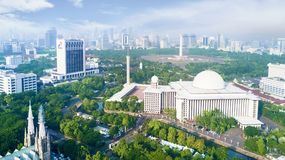 Largest Istiqlal mosque in the downtown. Jakarta, Indonesia. February 22, 2018: largest Istiqlal mosque with office building in the downtown Stock Photo