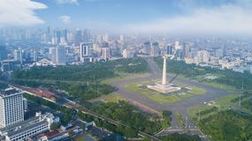 National Monument at morning time. Jakarta, Indonesia. February 22, 2018: National Monument and city skyline at morning time Royalty Free Stock Image