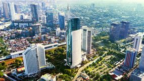 Aerial photo of iconic BNI 46 Tower with office buildings located in South Jakarta Central Business District,. JAKARTA - Indonesia. March 12, 2018: Aerial photo stock image