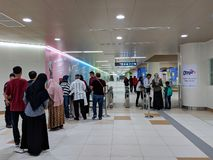 MRT Jakarta. Jakarta, Indonesia - March 23, 2019: Crowd of people standing in line for MRT Jakarta trial trip registration at Dukuh Atas BNI Station stock photos