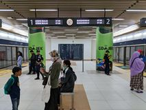 MRT Jakarta. Jakarta, Indonesia - March 23, 2019: People strolling around the platform of Dukuh Atas BNI MRT Station royalty free stock photo