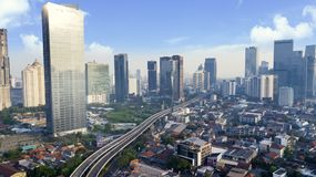 Jakarta city at sunny day. JAKARTA - Indonesia. May 21, 2018: Aerial view of Jakarta city with skyscrapers and highway at sunny day Stock Image