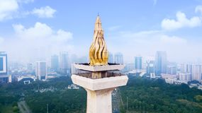 Beautiful gold torch of the National Monument. JAKARTA - Indonesia. May 21, 2018: Beautiful gold torch of the National Monument under clear sky Royalty Free Stock Photo