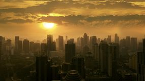 Downtown Jakarta at sunset time. JAKARTA - Indonesia. May 21, 2018: Silhouette of office buildings in downtown Jakarta at sunset time Stock Photography