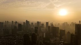 Silhouette of Jakarta skyscrapers at sunset time. JAKARTA - Indonesia. May 21, 2018: Silhouette of skyscrapers in downtown Jakarta at sunset time Stock Photo