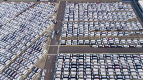 New cars shipped around the world. JAKARTA - Indonesia. May 09, 2018: Top view of new cars parked in rows while waiting to be shipped around the world in Jakarta royalty free stock photo