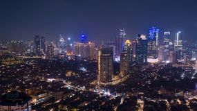 Aerial view of modern office buildings at night time in Jakarta stock photo