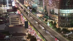 Timelapse of traffic jam in Jakarta. JAKARTA, Indonesia. November 13, 2017: Aerial view timelapse of traffic jam on the highway at night in Kuningan CBD. Shot in stock video footage
