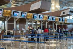 Garuda Indonesia airline check-in counter at Jakarta Soekarno-Hatta International Airport. Jakarta, Indonesia - November, 2017: Garuda Indonesia airline check Royalty Free Stock Photos