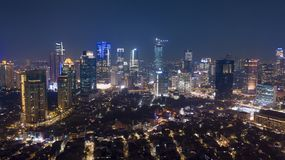 Night view of Jakarta downtown with residential house and skyscrapers royalty free stock photography